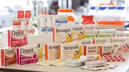 Collection of different types of Strepsil boxes, packets and tubs