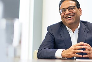 Laxman Narasimhan (RB CEO) smiling while sitting in meeting room