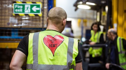 Factory worker in Hull wearing hi vis jacket with safety at heart logo on back